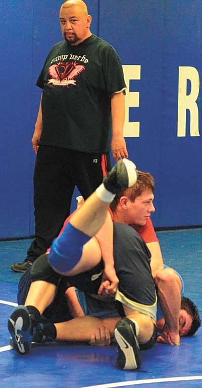Ryan Allred, left, and Jeremy McEachern wrestle during practice. VVN/Derek Evans.
