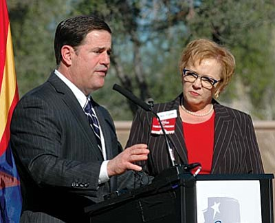 In his State of the State Address, Arizona Governor Doug Ducey, left, called for creating an Arizona Public School Achievement District that would turn over space that isn't being used by traditional schools to charter schools and other qualifying schools.