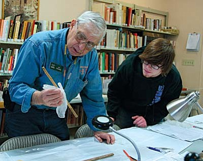 Jim Graceffa, left, president of the Verde Valley Archaeology Center board, and VVAC member Jake Nicosia, look at one of the more than 20,000 artifacts that comprise the Paul Dyck Collection. VVN photo by Bill Helm