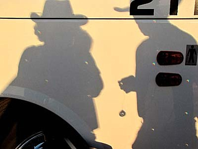 A prism throws tiny eclipses across the side of the bus.