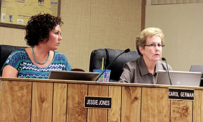 Camp Verde Town Council members Jessie Jones and Carol German, from left, listen to arguments supporting and in opposition of the Town's proposed fiscal year 2015-2016 budget. Council will hear public fedback on the budget on July 15. VVN photo by Greg Macafee