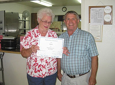 The Camp Verde Senior Center is happy to name Rita Graham and Aaron Cook as Volunteers of the Month for the month of September. Rita, pictured, enjoys volunteering at the front desk, as well as seeing and talking to the people as they come in the Camp Verde Center. (Courtesy photo)