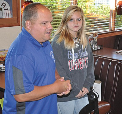 The Camp Verde Kiwanis Club honored its Students of the Month at the club's monthly meeting on Thursday, Oct. 8. <br /><br /><!-- 1upcrlf2 -->The three honorees were Brittany Gunther, a straight-A eight-grader at Camp Verde Middle School, Cade Petefish, a senior form Camp Verde High School who is headed to ASU to study business management, and Kaylee Oesterreich, a Camp Verde High School senior who currently serves as the student body president, president of FFA and Key Club president. <br /><br /><!-- 1upcrlf2 -->Pictured are Gunther, top photo right with Camp Verde Middle School Principal Danny Howe; and Petefish, bottom photo right with Camp Verde High School Principal Bob Weir. (Courtesy photos)