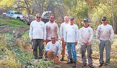 River crew members (kneeling) Sean Borruso, crew chief and (from left) Mike Gioia, Lyle King, Eamonn Stewart, Dennis Rhoades, Dave Rickard, James Privett (Courtesy Vetraplex-Vets4Hire)