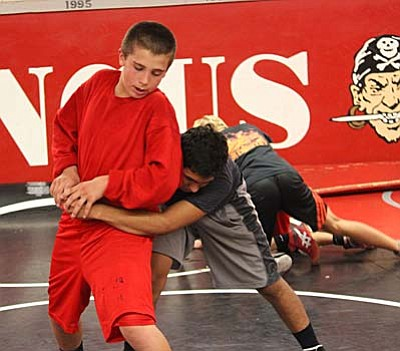 One Mingus wrestler tries to escape from the other during a drill on Tuesday as Mingus prepares for their first meet of the season.(Photo by Greg Macafee)