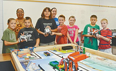 Onica Stout (center) is surrounded by fellow classmates on a Friday morning in the robotics lab at Camp Verde Elementary School. (Photo courtesy of Don Decker)