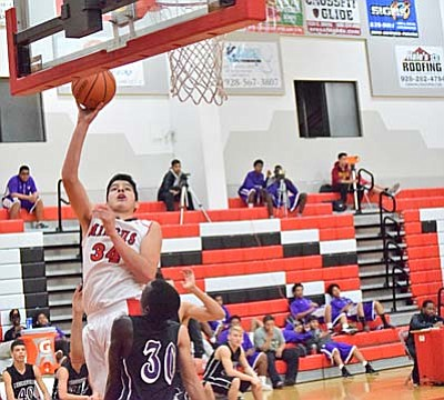 Mingus Center Gerardo Angulo shoots a lay-up during the first half Friday night. Angulo finished with 16 points and 12 rebounds for the Marauders. (Photo by Greg Macafee)