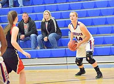 Camp Verde forward Kayla Hackett looks for an open teammate Tuesday night against Combs. Hackett earned the start Tuesday night after returning from injury to give a boost to the Cowboys. (Photo by Greg Macafee)