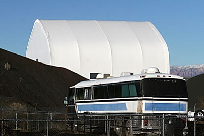 ADOT's white tent-like object on Finnie Flat Road is a building they are using to store equipment and materials to be used on Camp Verde roads. (Photo by Bill Helm)