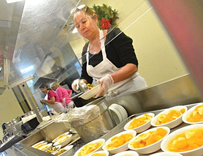 The Verde Valley Senior Center home delivers approximately 225 meals every day, in addition to the many meals they serve in a community dining setting at the senior center. (Photo by Vyto Starinskas)