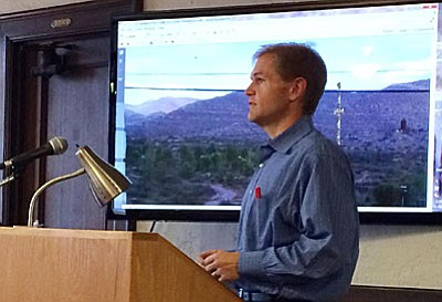 Reg Destree of SBA presenting a similar cell tower at a nearby community. (Photo by Tom Tracey)