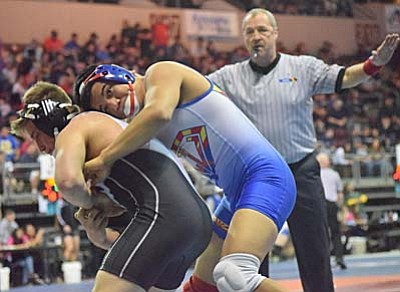 Favian Chagolla wrestles an opponent at this years Division IV State Meet. (Photo by Greg Macafee/VVN)