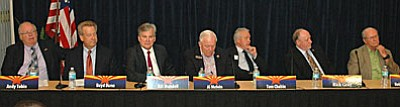 Corporation Commission candidates Andy Tobin, Boyd Dunn, Bill Mundell, Al Melvin, Tom Chabin, Rick Gray and Bob Burns debating utility issues on Wednesday. (Capitol Media Services photo by Howard Fischer)