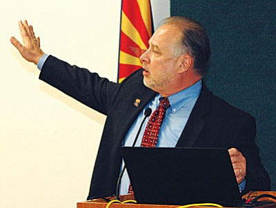 ADOT Director John Halikowski details for a special panel Monday some of the advantages and some of the legal issues of Arizona allowing driverless vehicles on state roads. (Capitol Media Services photo by Howard Fischer)