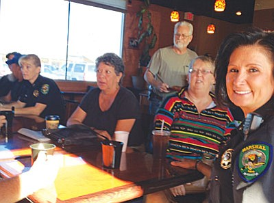 Town of Camp Verde officials in attendance at Coffee with a Cop include Commander Jacquelyn MacConnell (second from left), Council member Brad Gordon (standing) and Marshal Nancy Gardner (right). (Photo by Tom Tracey)