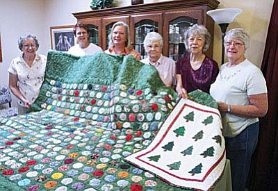 More than 70 quilted items will be on display for the biennial Fort Verde Days Quilt Show, held Oct. 8-9 in the Town of Camp Verde's Community Center gymnasium. The gym's interior walls will also be lined with tables filled with fabric crafts for sale by the Verde Valley's craftiest people. Members of the Fort Verde Days Quilt Show Committee prepare for the biennial show of quilts and fabric crafts, Oct. 8-9. (Photo by Bill Helm)