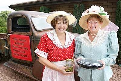 During the annual Fort Verde Days parade, Verde Valley Questers Malia Adache and Diana Hopper, from left, will ride in the 1942 Chevy truck to promote their Pickles and Pies fundraiser to help restore the Historic Hance House on Coppinger Street. (Photo by Bill Helm)