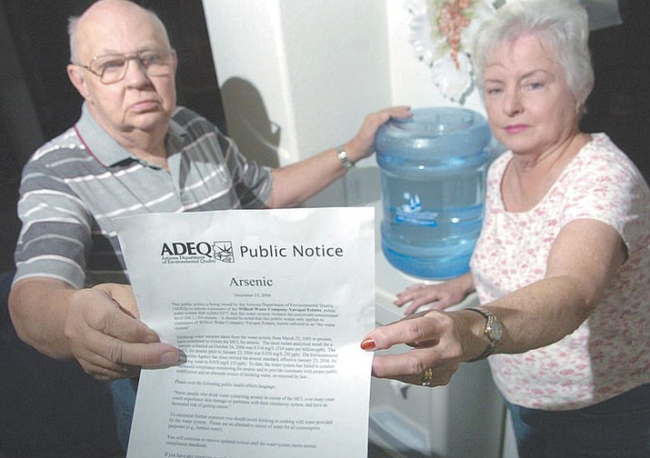 Review file photo On Dec. 22, 2006, Ed and Bonnie Yeager of Chino Valley hold up an Arizona Department of Environmental Quality public notice titled 'Arsenic' which states that the water in their community violates the maximum contaminant level of arsenic as they stand next to their newly bought water dispenser in their home.