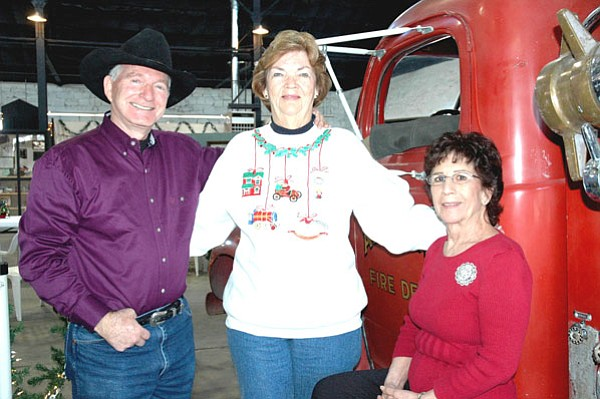 Chino Valley Historical Society president, Kay Jones, center, and member, Bobbi Wicks, right, pose with Arizona Historian, Marshall Trimble at the Ash Fork Historical Society Open House in December. <br>Courtesy Photo Laura Flood