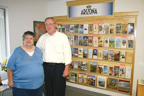 Review/Salina Sialega Above, Linda McFarland, left, administrative assistant for the Chino Valley Chamber of Commerce, and Ab Jackson, chamber CEO and executive director, pose in front of the chamber's new Arizona Tourism Office Enhancement Center.   At right, Jackson shows one of two signs on Highway 89 in Chino Valley that point travelers to the chamber as a designated Arizona Tourism Office. People can information about destination spots across Arizona and the West Coast.