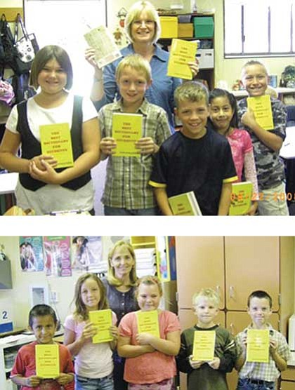 Top, Susan Davidson, and some of her students,  Brittany Resenev, Gavin Clouff, Jonas Yarbro, Jasmine Quezada and Logan Bates, show their dictionaries. Bottom, Del Rio's Principal Susan Clark with some students from Linda Donaldson's class, David Gehman, Spencer Willis, Aryanna Jordan, Ryelee Cloudt and Michael Pina.