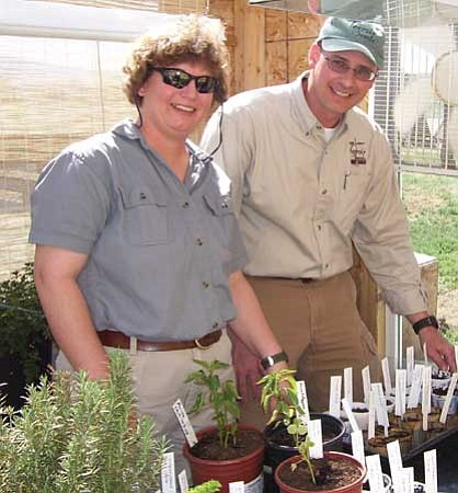Stephen and Cindy Scott of Chino Valley check the seedlings in the greenhouse at Underwood Gardens at their home.