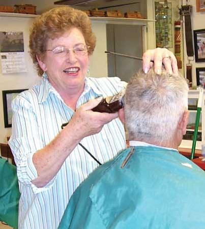 Birdie Bennett cutting Pat Valdez' hair