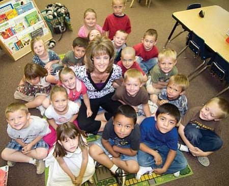 Special to the Review/Les Stukenberg<br /><br /><!-- 1upcrlf2 -->Del Rio Elementary School kidergarten teacher, and Yavapai County Education Foundation 2009 Teacher of the Year, Brandy Cox with her class on May 11.