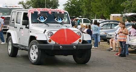 Penny Hubble from State Farm Insurance in Chino Valley brings her Jeep to life with lips and eyes with eyelashes at the First Territorial Capital Days parade on Sept. 5. Photo by Salina Sialega