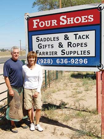 Review/Salina Sialega<br /><br /><!-- 1upcrlf2 -->Pat Earle, owner of Four Shoes, Inc., in Chino Valley, and her husband, Bob, a farrier, stand by the saddle & tack shop's sign at 2093 N. Highway 89.