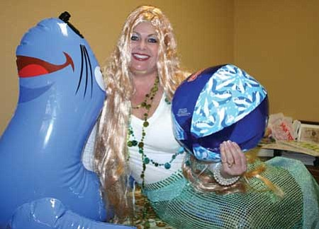 "Review/Salina Sialega<br /><br /><!-- 1upcrlf2 -->DiAnna Hardel will dress up as the Little Mermaid, shown here with a blow-up seal and a beach ball, at the women's retreat, ""Fairy Tale Princesses Living Very Real Lives,"" on Saturday, Oct. 24, 10 a.m.-3 p.m. at the First Southern Baptist Church of Chino Valley. Tickets for $5 each, includes a catered lunch and are on sale now."