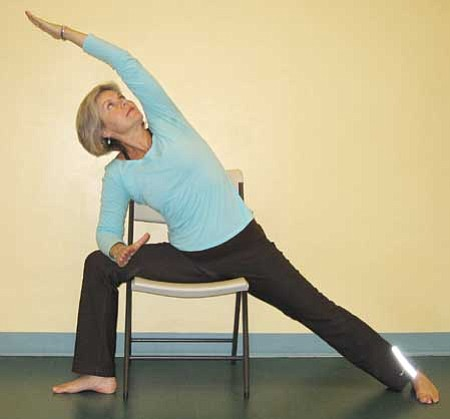 Instructor Cheryl Van Demark demonstrates yoga positions for advanced students - shown here front angle.<br /><br /><!-- 1upcrlf2 -->Courtesy photos