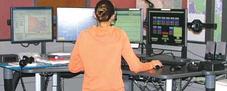Courtesy photo A Communication Specialist for the Yavapai County Sheriff's Office works at a communications console inside the Dispatch Center.