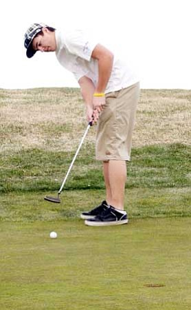 Review/Geri Kinsley Cougar Justin Ludwig putts during a team practice round of golf March 22 at the Antelope Hills Golf Course in Prescott.