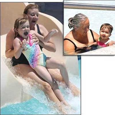 Review/Geri Kinsley<br /><br /><!-- 1upcrlf2 -->Joell Gall and her daughter, McKenna, 5, above, fly down the slide at the Chino Valley Aquatic Center during Adult TOT swim this past week. At right, Kay Mac Inness and her 1-year-old granddaughter, Drina Flores, enjoy the water during Adult TOT swim this past week. <br /><br /><!-- 1upcrlf2 -->