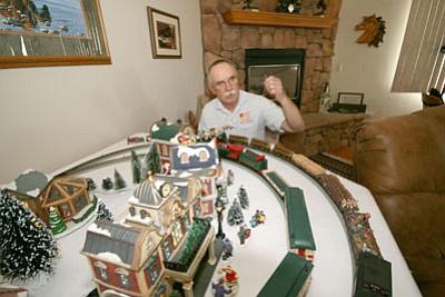 Review/Matt Santos<br> Paulden resident Donn Pease invites the public to view his elaborate model train exhibit during the CAMRRC Open House to be held this Saturday from 1 p.m. to 5 p.m. Pease has based his creation on historic train stations form Bisbee, Douglas, and Tucson.