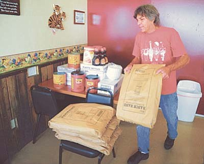 Les Stukenberg/PNI<br /><br /><!-- 1upcrlf2 -->Robert Arnold stacks some of the pancake batter he bought for Saturday's Territorial Days breakfast at his Café 89 restaurant in Chino Valley. The all-you-can-eat breakfast costs $5 and the Lions Club plans to begin serving at 6 a.m. at the Senior Center.<br /><br /><!-- 1upcrlf2 -->