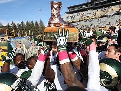 Colorado State University Press/Courtesy photo<br /><br /><!-- 1upcrlf2 -->The tradition of a bronze boot trophy is not unique to Chino Valley and Camp Verde high schools. Colorado State University, its team pictured here hoisting the traveling bronze boot in 2013, has competed annually with the University of Wyoming for possession of the trophy since 1968.