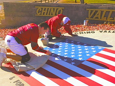 Jason Nance (left) and Josh Balazs of B&M Painting, paint the memorial to victims of the Sept. 11, 2001 terrorist attacks at Memory Park in Chino Valley. They contributed the labor and Sherwin-Williams contributed the paint. (Ken Sain/Review)<br /><br /><!-- 1upcrlf2 -->