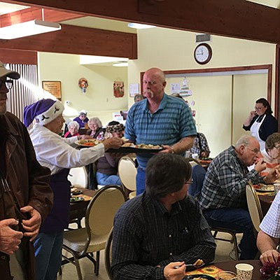 Chino Valley Town Council member Jack Miller serves food to residents on Wednesday, Nov. 25 at the Senior Center. (Ken Sain/Review)