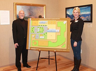 Yavapai Humane Society Executive Director Edward Boks and Director of Equine Initiative Nina Ekholm Fry show the site plan for their new equine center in Chino Valley. (Courtesy photo)