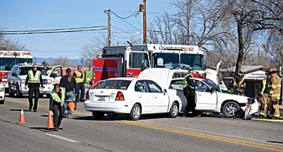 Chino Valley police and fire fighters work the scene of a two-vehicle collision near the intersection of Highway 89 and Road 1 North Tuesday afternoon in Chino Valley. Drivers from both vehicles were transported by Lifeline Ambulance Yavapai Regional Medical Center with injuries. (Matt Hinshaw/PNI)