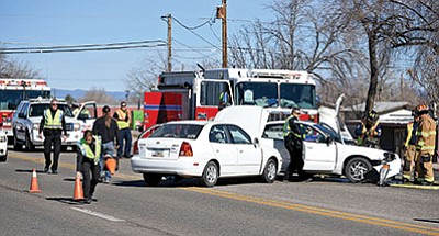 Chino Valley police and fire fighters work the scene of a two-vehicle collision near the intersection of Highway 89 and Road 1 North on Jan. 26, the most recent of 31 crashes there in the past five years. (Matt Hinshaw/PNI)