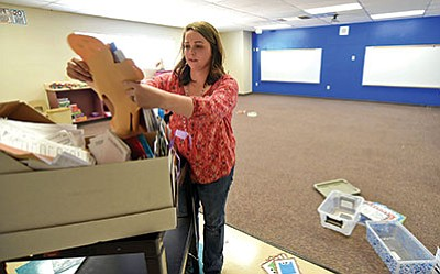 Territorial Early Education Center kindergarten teacher Kait Fletcher unpacks items from a box in her new classroom Feb. 25 in Chino Valley. Her class moves into its new classroom on Monday, March 14. (Matt Hinshaw/PNI)