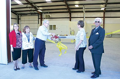 Chino Valley School Board President Peter Atonna dedicates the district's new bus barn, joined by Governing Board members (from left) Cyndi Thomas, Sherry Brown, Penny Hubble and Daniel Chacon. Atonna, Brown and Chacon have said they are running for reelection this year. Those are the only three seats open in 2016. (2015 Review file photo)