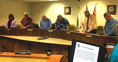 Councilmember Mike Best (right) conducts the invocation at the April 12 meeting. Under the new rules council adopted later that meeting, it will be the last public invocation Chino Valley Town Council does.