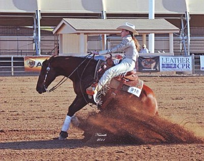 "Courtesy Photo<br /><br /><!-- 1upcrlf2 -->Blair Willette, a 16-year-old Williamson Valley resident, competes in a reining event with her horse ""Whizin In the Dirt""."
