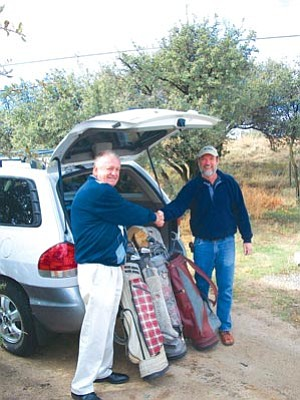 Courtesy photo<br> Mack McCarley, general manager at Antelope Hills Golf Course, and Patrick Holt, operations manager for the Prescott Habitat for Humanity ReStore, unload 15 sets of golf clubs and bags which the Habitat Store donated. The clubs will be given to Special Olympians and to local high school golfers who do not have equipment.