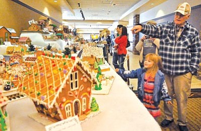 Matt Hinshaw/The Daily Courier<br>John Michalok and his granddaughter Isabela Marquez, 5, check out the 2010 Gingerbread Village at the Prescott Resort.