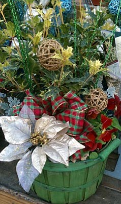Courtesy photo<br>Holiday porch pots are living floral arrangements meant to live out by the front door through the holidays.